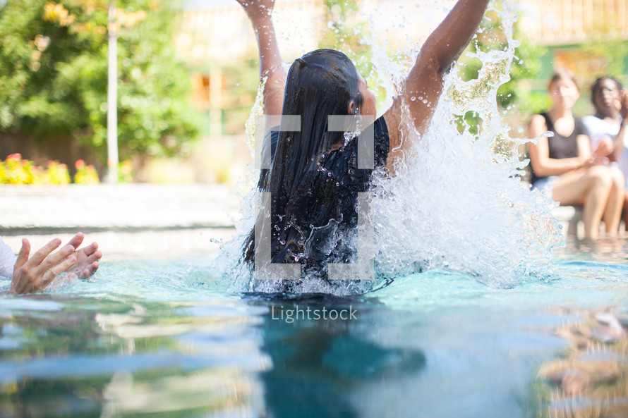 a woman being baptized in water