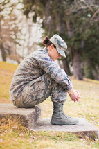 female soldier praying