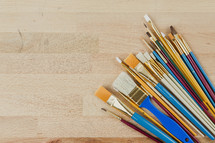 paint brushes on wood