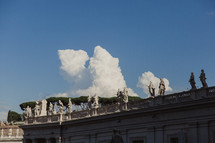 Statues lining the tops of buildings in the Vatican