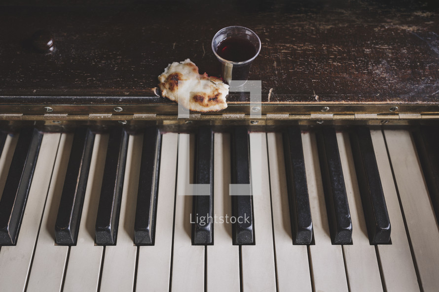wine and bread on piano for communion service