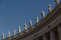 statues lining the roof in the Vatican