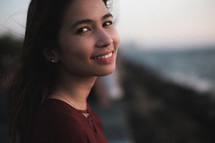 face of a smiling young woman