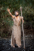 John the Baptist with a staff in the wilderness ready to baptize and prepare the way for the coming King. Voice of calling in the wilderness. Dedicated disciple and biblical character follower of jesus. Moses crossing the Red Sea, Moses staff.