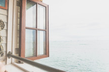 open window with an ocean view