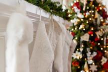 white Christmas stockings on a mantel