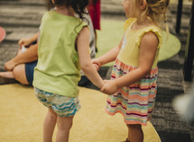 toddler girls holding hands