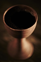 Communion chalice filled with wine