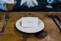 bride place card at a wedding reception