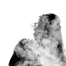 A woman engulfed in smoke