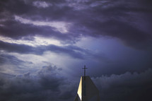 a stormy sky above cross
