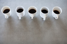 a row of coffee mugs