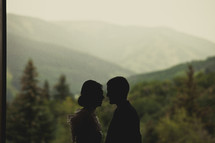 silhouette of a couple about to kiss