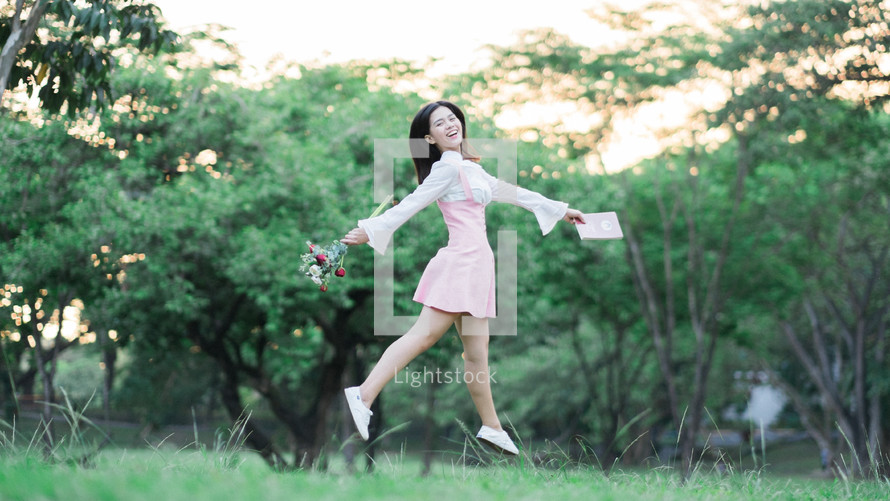 an excited girl with a card and bouquet of flowers