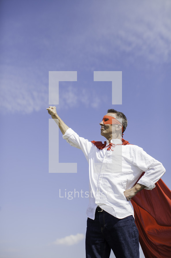 A Dad in a superhero cape with raised fist