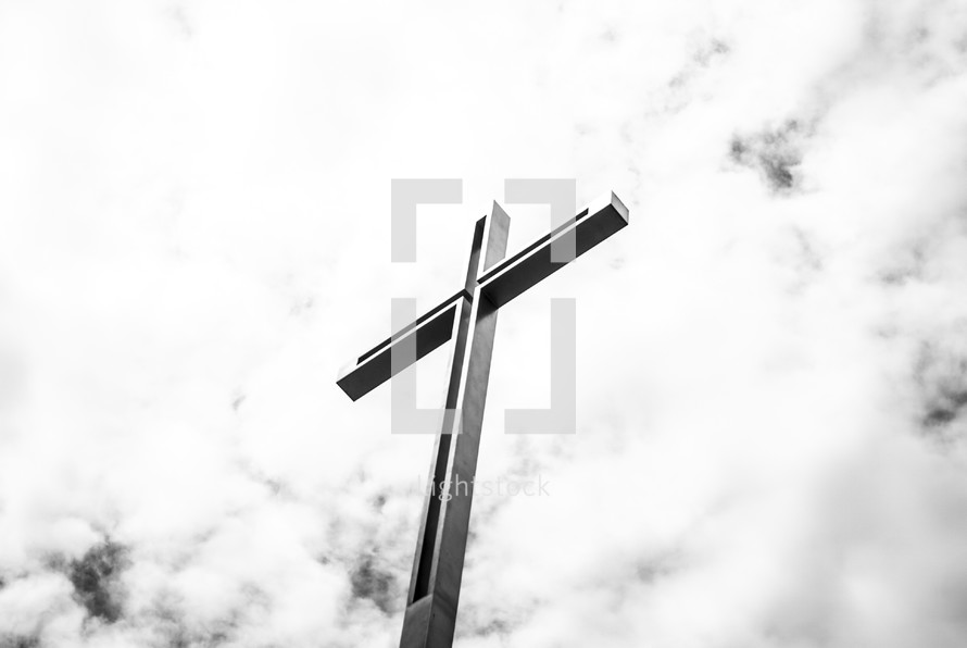 cross against clouds in the sky