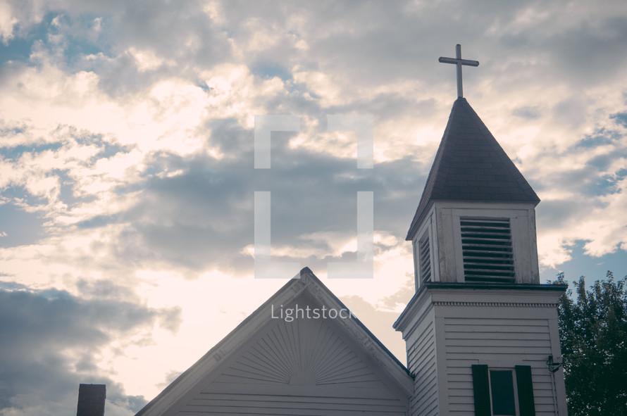 a small white church steeple