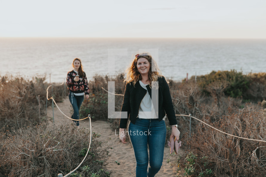 friends walking on a beach access trail