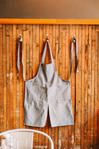 An apron hanging on a hook.
