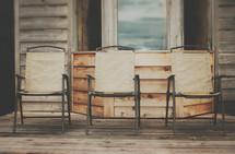 wood chairs on a porch