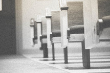 Rows of church pews.
