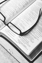 reading glasses on a Bible - seeking clarity