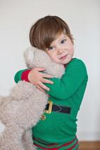 toddler hugging a stuffed animal