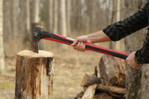 chopping wood with an ax