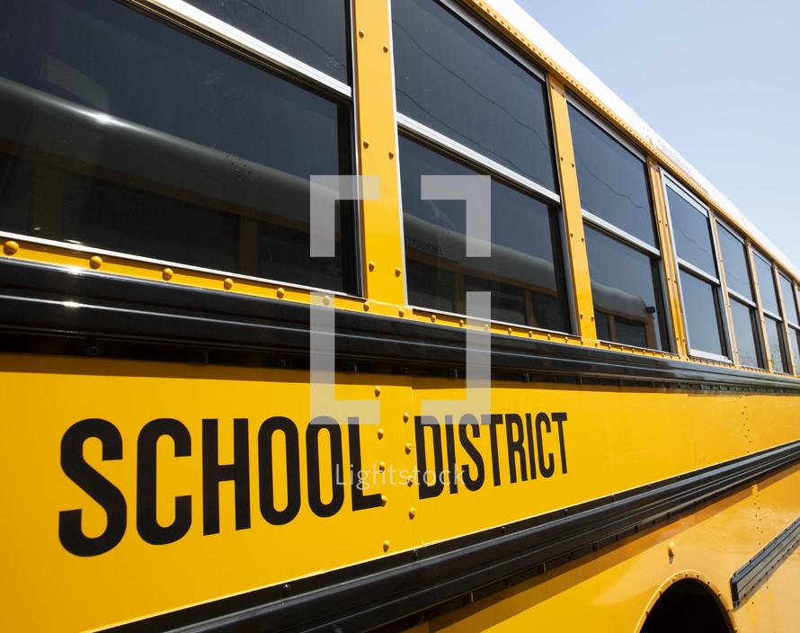 school district sign on school bus
