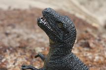 a toy dinosaur looking ferocious