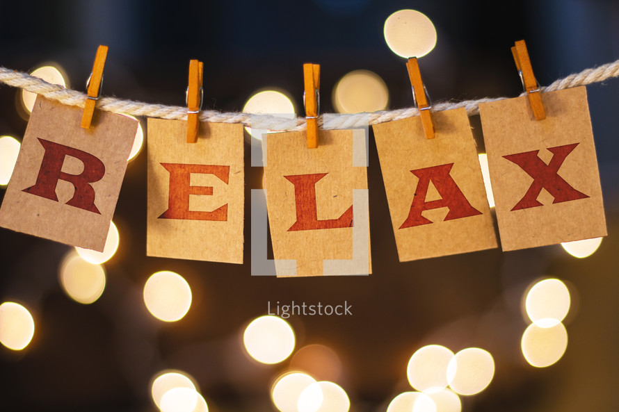 word relax hanging on clothes pins