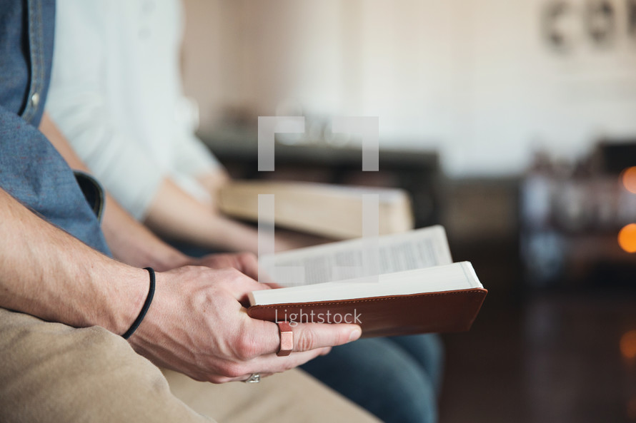 men reading Bibles together at a Bible study