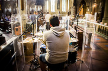 a man playing drums in a church