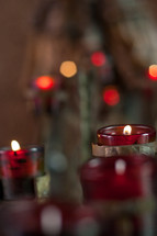 red votive prayer candles