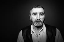 headshot of a bearded man