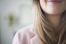 lips of a woman wearing a pink blazer