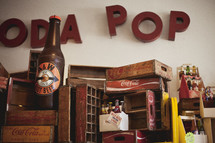 antique soda pop bottles and crates