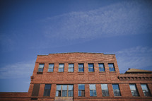 An old red brick building with many windows