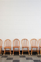 Row of wooden chairs.