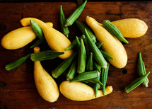 squash and okra on a table