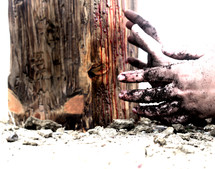 dirty hands digging in dirt