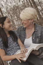 woman and a girl reading a Bible together - mentoring