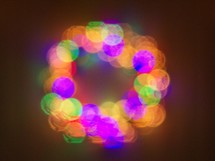 Christmas light decorations form the shape of a wreath