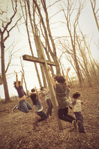jumping for joy around a cross outdoors