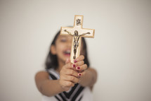 a woman holding up a crucifix