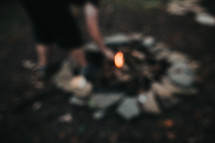 lighting a fire in a fire pit