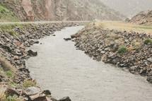 A stream flowing through mountains.