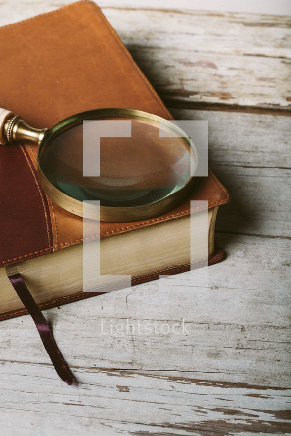 magnifying glass on a Bible
