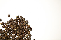 A pile of coffee beans isolated on white