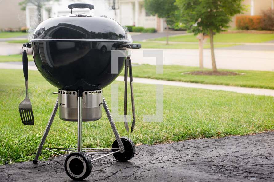 grill on a driveway